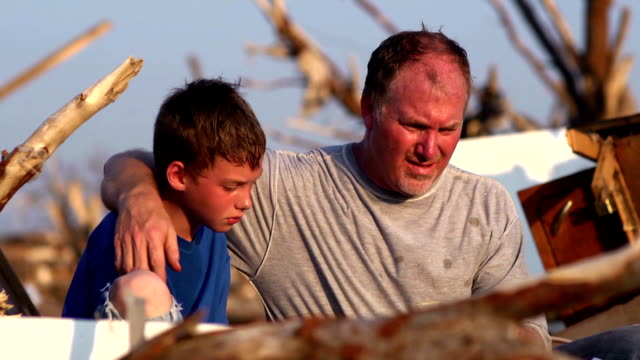 stockvideo's en b-roll-footage met father and son - natural disaster - beschadigd