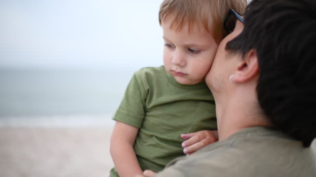 father and son near the sea - son stock videos & royalty-free footage