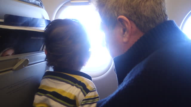 father and son on airplane - 65 69 years stock videos & royalty-free footage