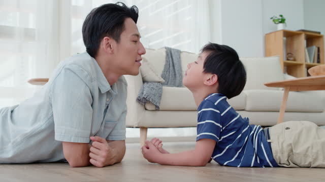 father and son on floor,4k - genderblend stock videos & royalty-free footage