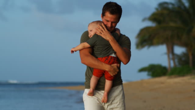 stockvideo's en b-roll-footage met father and son on the beach - genderblend