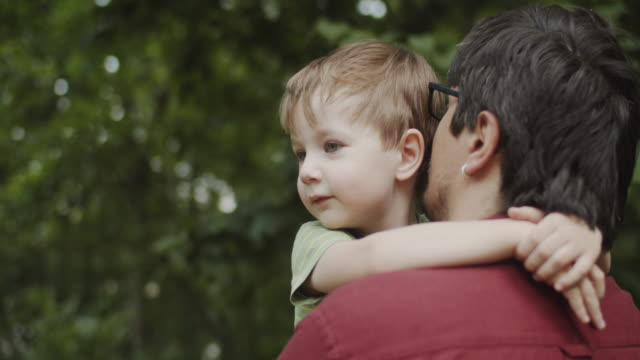 father and son outdoors in summer - modern manhood stock videos & royalty-free footage