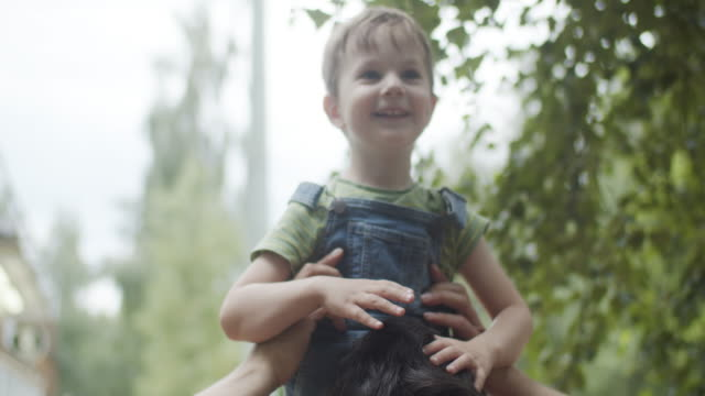 father and son outdoors in summer - genderblend stock videos & royalty-free footage