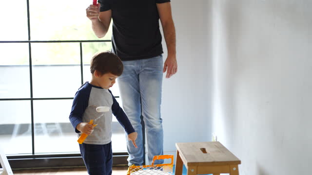 father and son painting the walls - diy stock videos & royalty-free footage