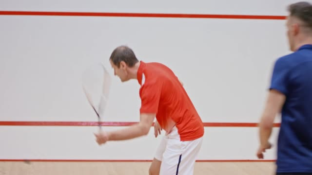 father and son playing a game of squash - squash sport stock videos & royalty-free footage