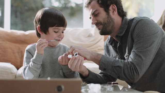 father and son playing and painting - genderblend stock videos & royalty-free footage