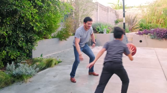 father and son playing basketball in backyard - son stock videos & royalty-free footage