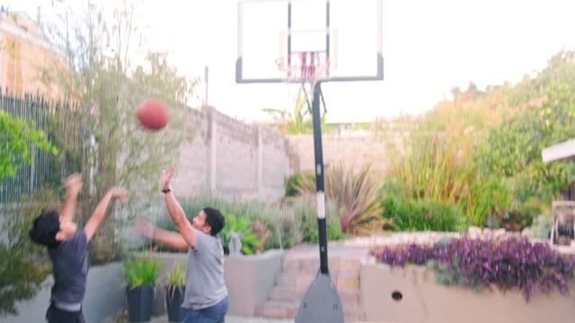 father and son playing basketball in backyard - sporting term stock videos & royalty-free footage