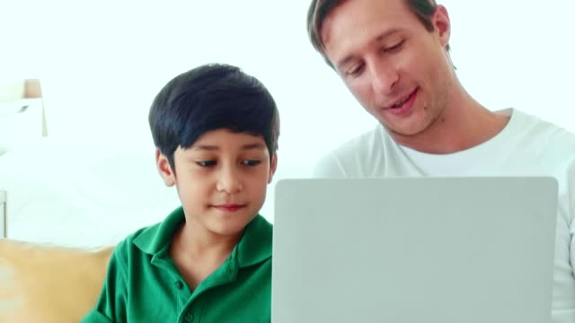 father and son playing computer - genderblend stock videos & royalty-free footage