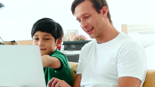 father and son playing computer - hot desking stock videos & royalty-free footage