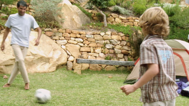 ms father and son (6-7) playing football / cape town, south africa - fifa world cup 2010 stock videos & royalty-free footage