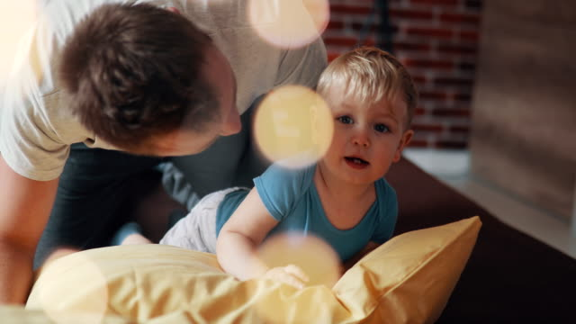 father and son playing in morning - modern manhood stock videos & royalty-free footage