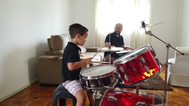 father and son playing music at home. - drummer stock videos & royalty-free footage