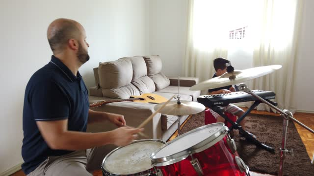father and son playing music at home. - drum percussion instrument stock videos & royalty-free footage