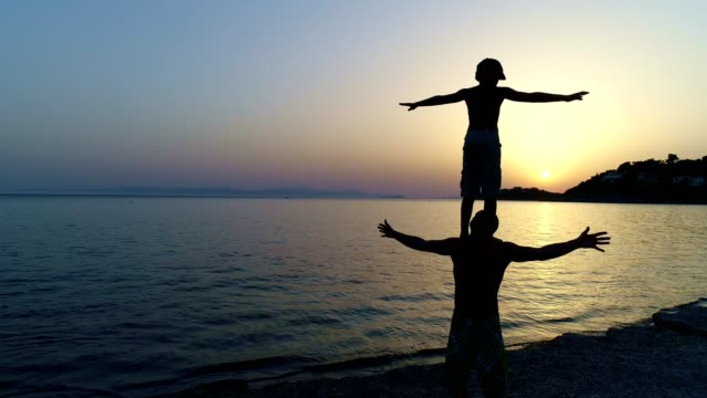 father and son playing on a sunset beach - single father stock videos & royalty-free footage