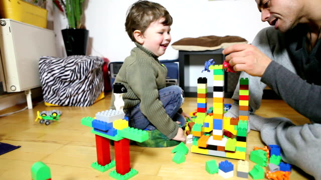 Father and Son playing lego