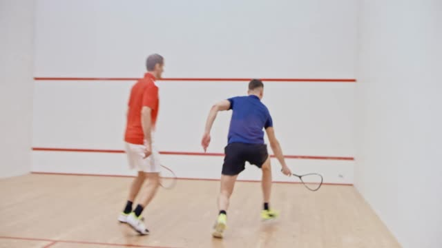 father and son playing squash - squash sport stock videos & royalty-free footage