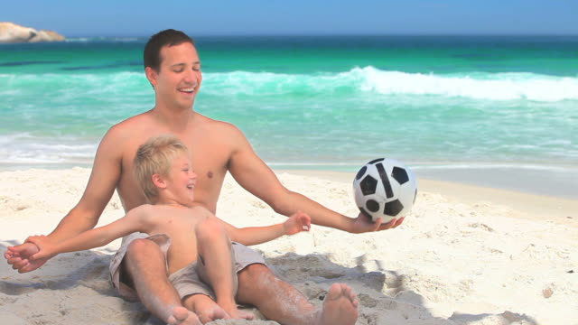 Father and son playing with a soccer ball / Cape Town, Western Cape, South Africa