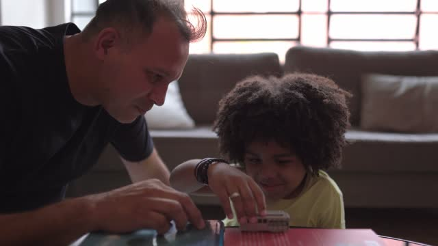 father and son playing with toy car at home - modern manhood stock videos & royalty-free footage
