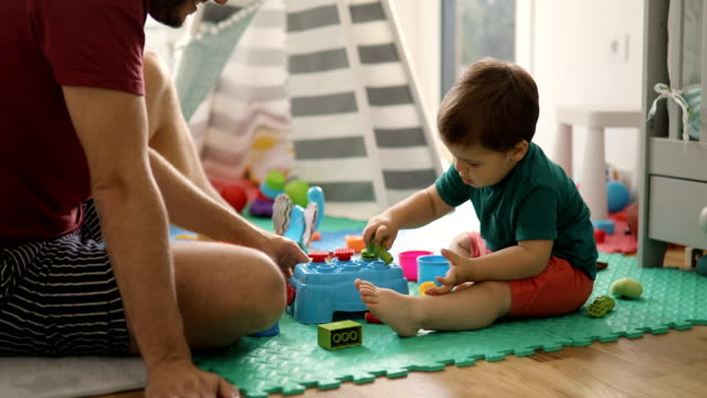 father and son playing with toys - genderblend stock videos & royalty-free footage