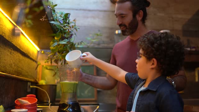 father and son preparing a smoothie at home - breakfast stock videos & royalty-free footage