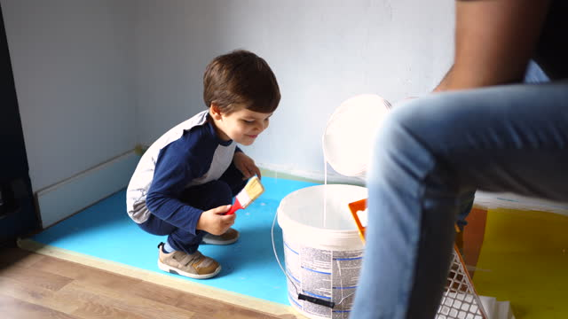 father and son preparing wall paint for diy project - diy stock videos & royalty-free footage