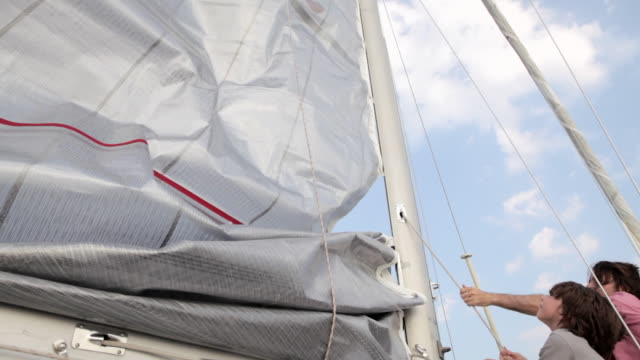 father and son raising sail on yacht - rigging nautical stock videos & royalty-free footage
