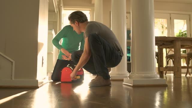 Father and son repairing a socket