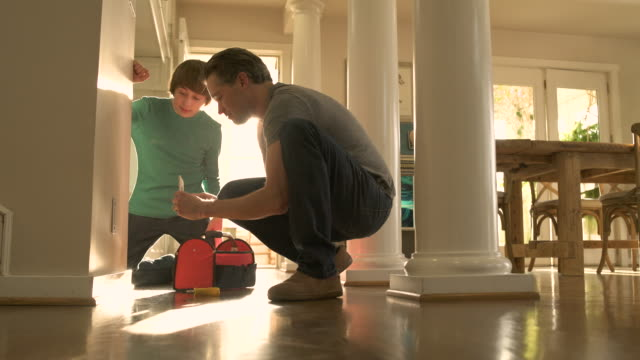 father and son repairing a socket - plug socket stock videos and b-roll footage