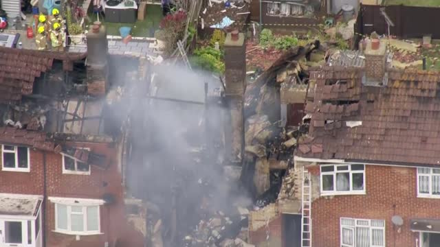 father and son rescue residents following gas explosion in ashford; england: kent: ashford: ext **hodges interview partly overlaid sot** air view /... - film composite stock videos & royalty-free footage