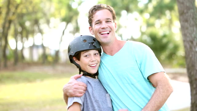 Father and son riding skateboards