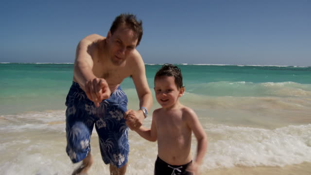 ms, father and son (2-3) running on beach, punta cana, dominican republic - punta cana stock videos and b-roll footage