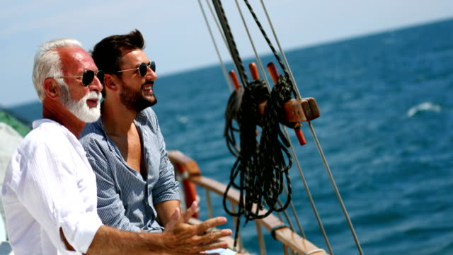father and son sailing. - sailing stock videos & royalty-free footage