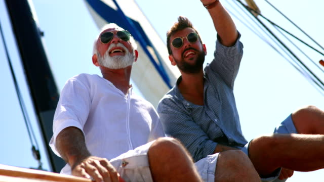 father and son sailing. - sunglasses stock videos & royalty-free footage