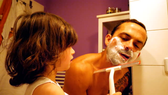 father and son shaving at the bathroom - shaving brush stock videos & royalty-free footage