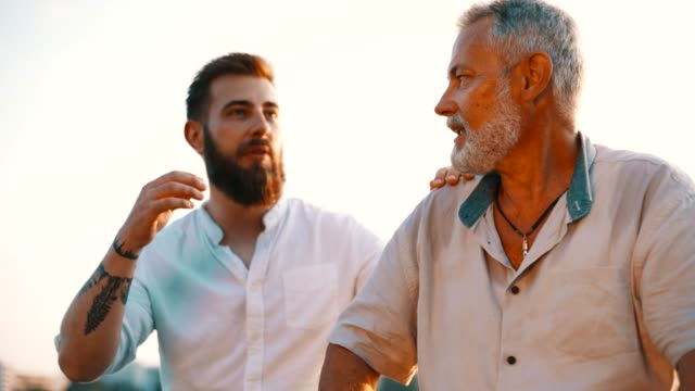 father and son sitting by the river - beard stock videos & royalty-free footage