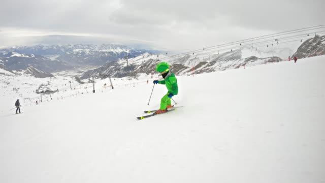 father and son skiing at glacier in the alps - sci e snowboard video stock e b–roll
