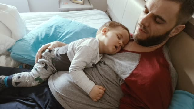 father and son sleeping - single father stock videos & royalty-free footage