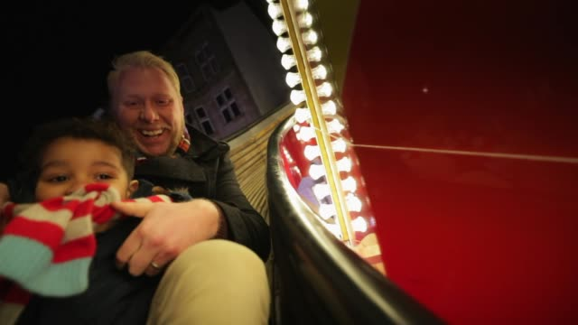 father and son sliding down helter-skelter - fairground stock videos and b-roll footage