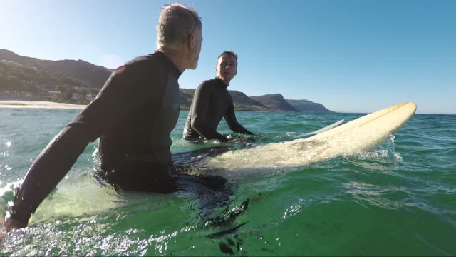 Father and son son surfing together
