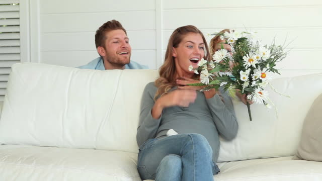 Father and son surprises the mother with flowers