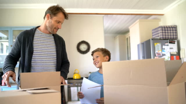 Father and son talking during moving house