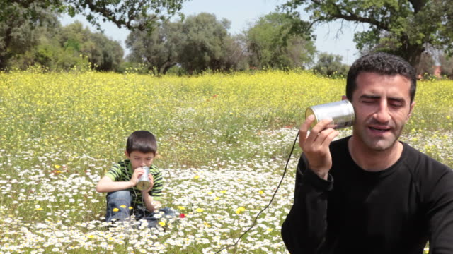 father and son talking on can phone - father's day stock videos & royalty-free footage