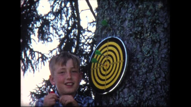 1966 father and son throwing darts in swiss countryside - dart board stock videos & royalty-free footage