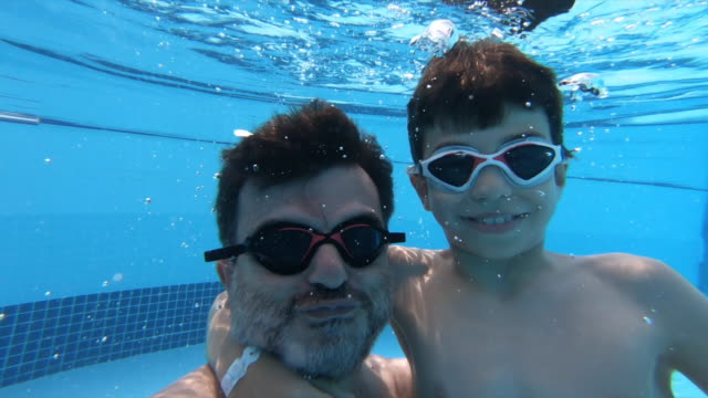 father and son underwater - middle eastern ethnicity stock videos & royalty-free footage