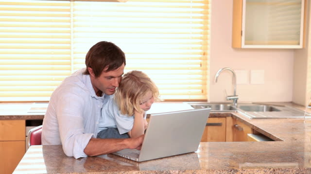 Father and son using a laptop together