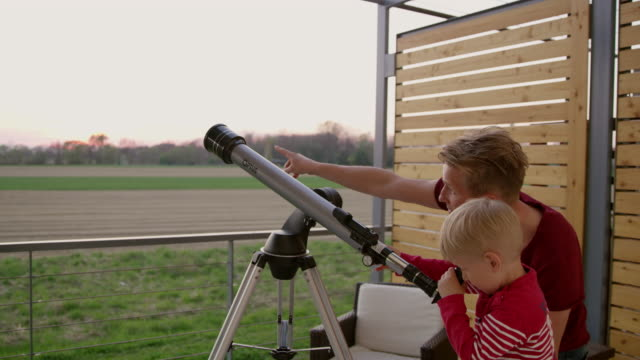 ds ms father and son using a telescope - space and astronomy stock videos and b-roll footage