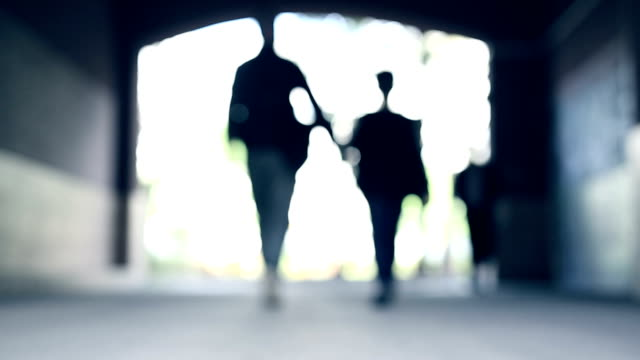 father and son walk together in tunnel - single father stock videos & royalty-free footage