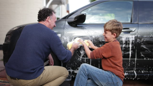Father and Son washing a car together