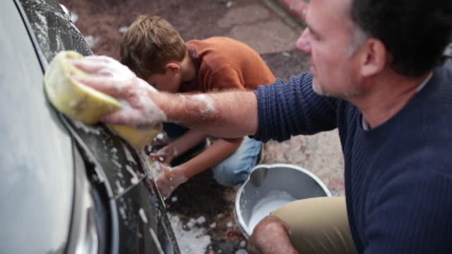 father and son washing a car together - washing stock videos & royalty-free footage